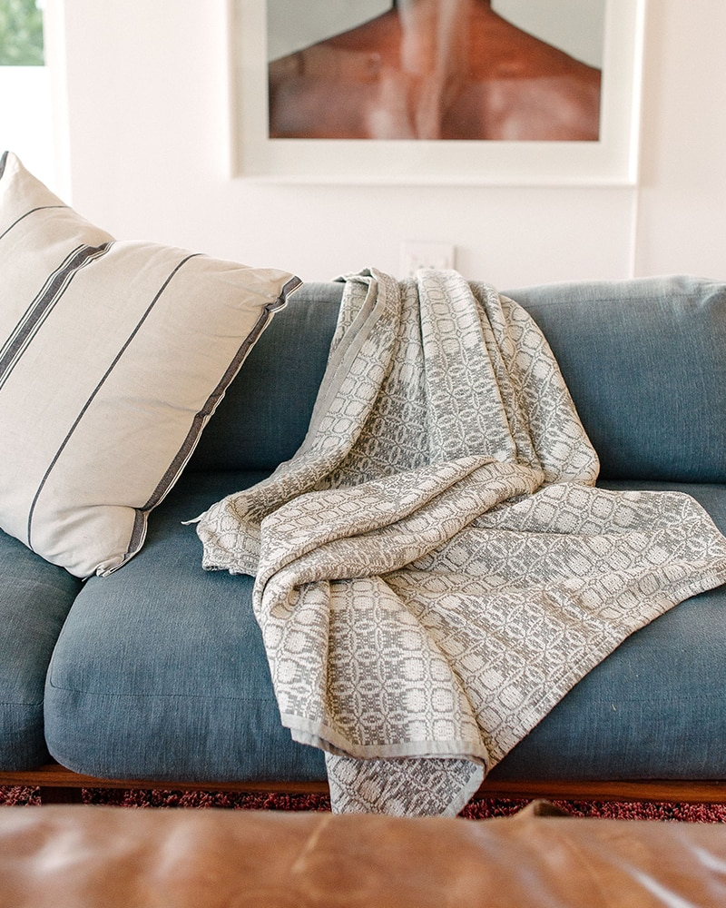 Mungo Juno Throw in Grey. 100% cotton throw, inspired by traditional 18th century American coverlets. Woven at the Mungo Mill in South Africa