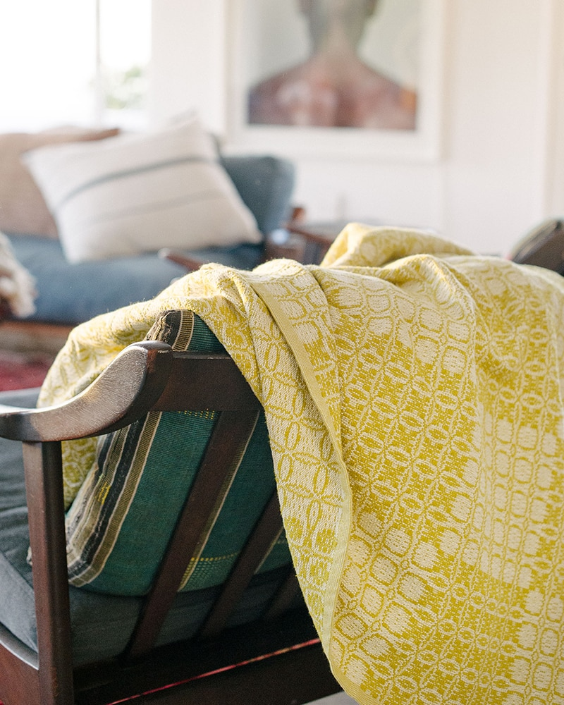Mungo Juno Throw in Mustard. 100% cotton throw, inspired by traditional 18th century American coverlets. Woven at the Mungo Mill in South Africa