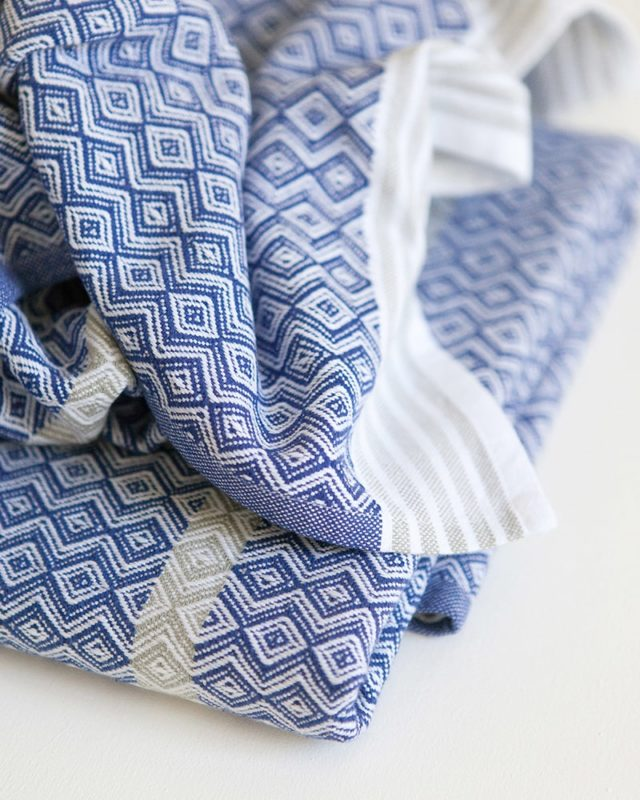 The Itawuli flat weave towel in blue and white, woven at the Mungo Mill in Plettenberg Bay
