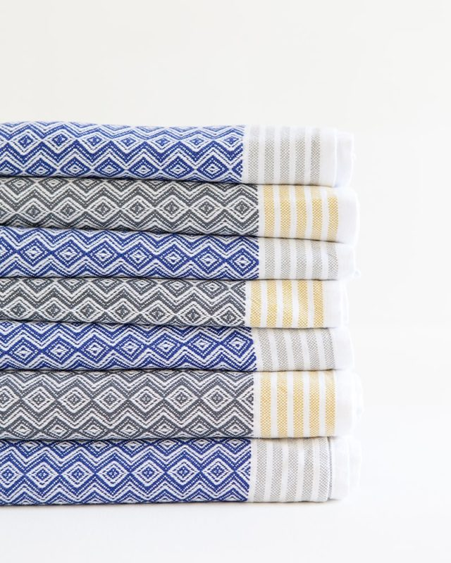 The iconic cotton Mungo Itawuli hand towels in Cango Grey and Blue Moon