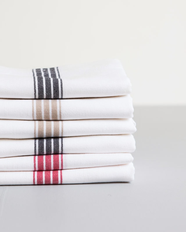 Mungo Provincial Stripe Napkins with various coloured stripes that run through the middles, inspired by french grain sacking material, pictured here in red, french navy and taupe