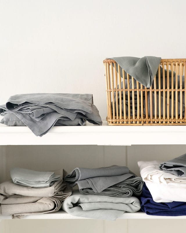 Mungo Kamma Linen at home in Bucatto Blue, Fumo Grey and Cripst white. Pure linen bedding woven in South Africa