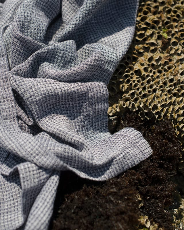 The Mungo 100% linen Dhow towel with a block weave is the perfect beach towel because it is lightweight and absorbent