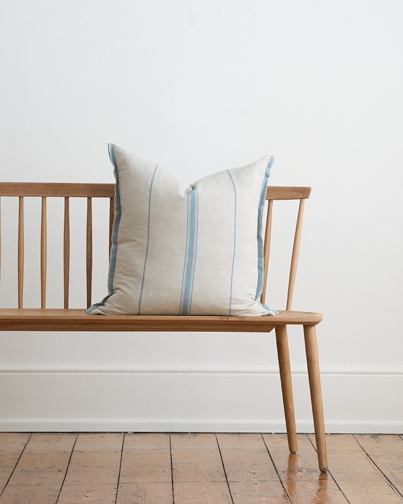The Mungo Lisburn Linen Cushion Cover with a bluebell stripe