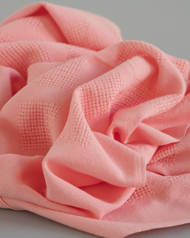 Mungo organic cotton baby blanket in Flamingo pink woven at our mill in Plettenberg Bay