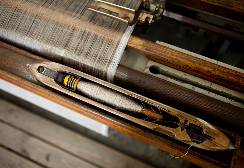 At the Mungo mill we have a variety of weaving machines, including ancient shuttle looms like the one pictured here