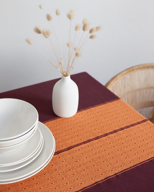 Mungo sunset Ottertrail tablecloth detail weave in African table setting