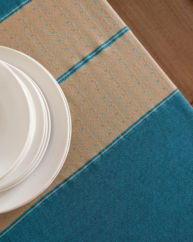 Mungo Otter trail tidal pool tablecloth showing African detail weave and size set table scene