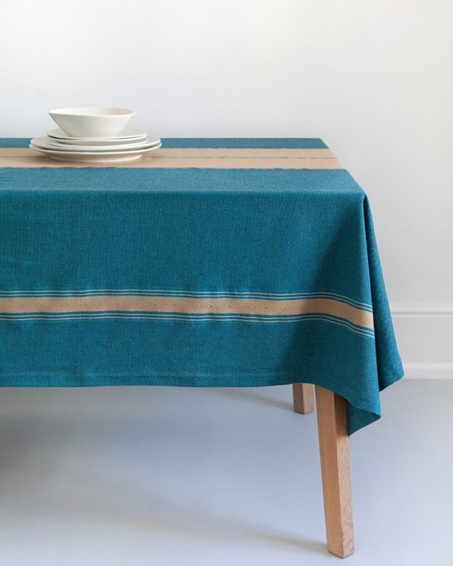 Mungo Ottertrail tidal pool tablecloth showing African detail weave and size set table scene