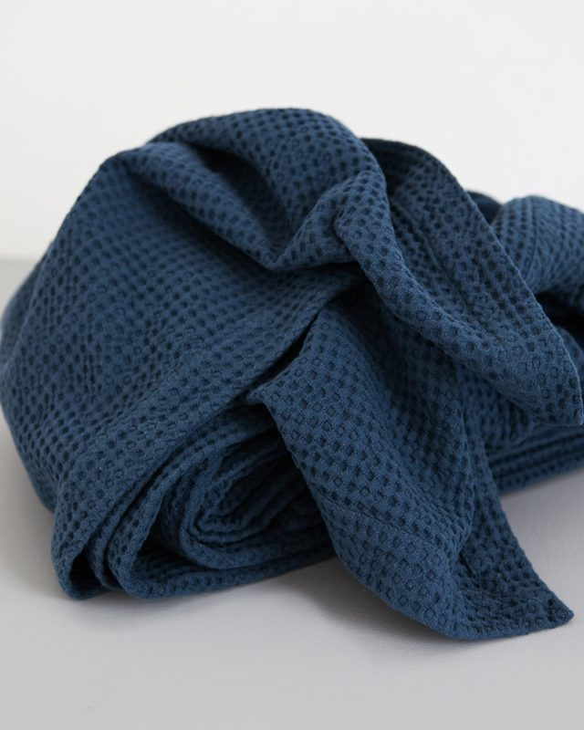 Mungo Cobble Weave bed cover in Petrol Blue showing detail intricate weave