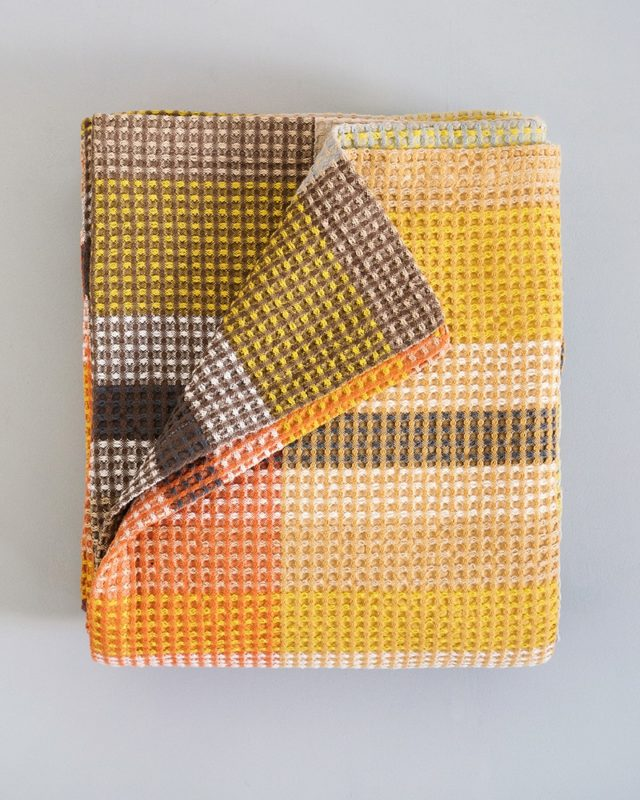 The Mungo Vrou-Vrou blanket seen here in the tamarind colourway. A beautiful blanket for your home.