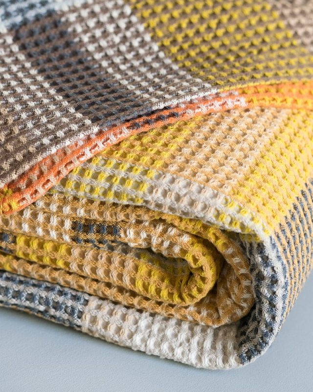 The Mungo Vrou-Vrou blanket is a new colourful blanket woven at our mill in Plettenberg Bay at Old Nick Village.