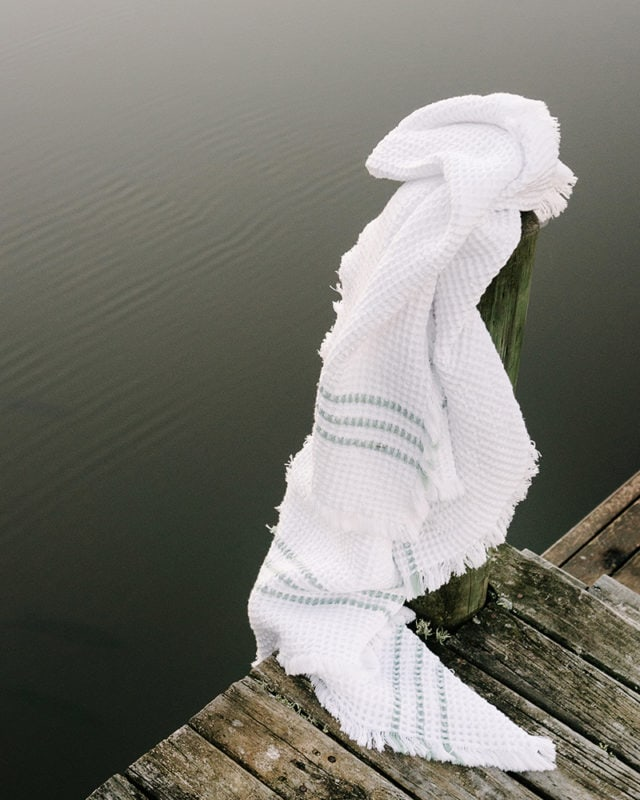 The Mungo Belgian Waffle Towel in duck egg next to lake in Plettenberg Bay