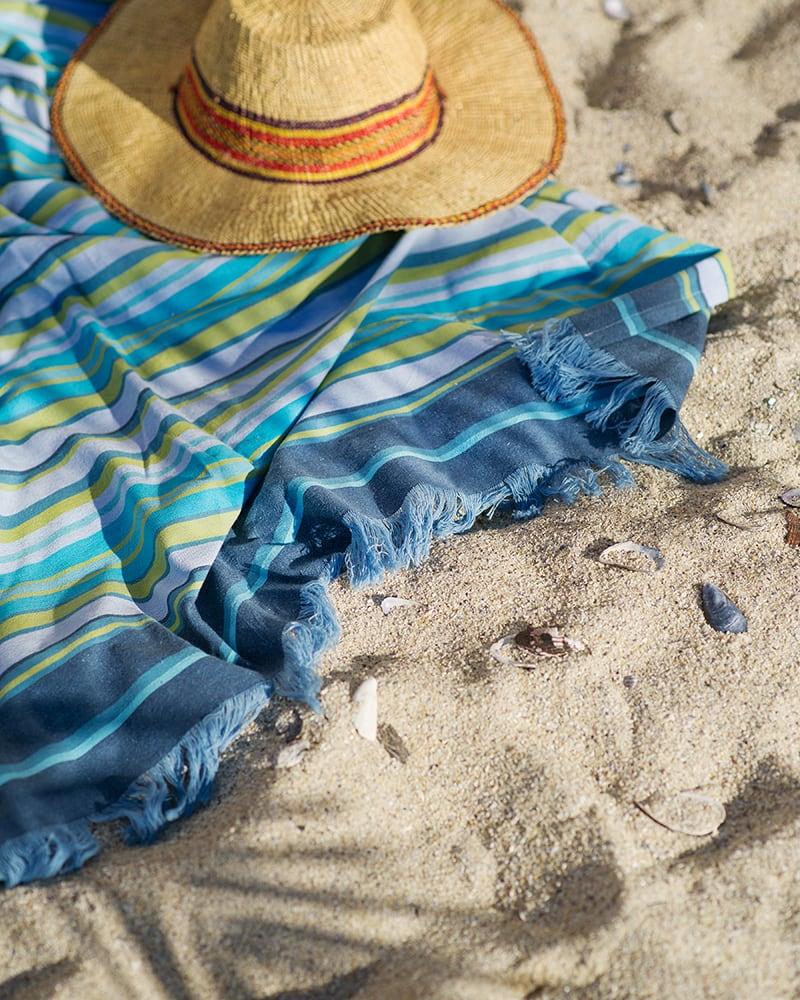 The Mungo 100% Cotton Kikoy South can be used as a versatile beach wrap, sarong or towel for tropical beach holidays