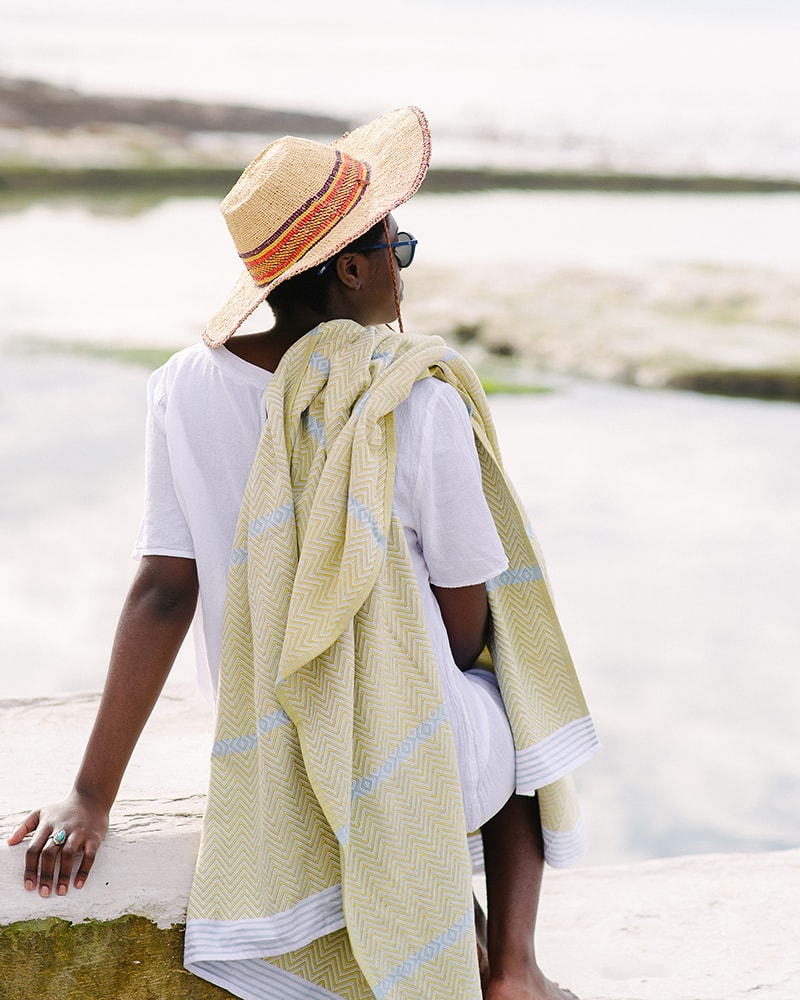 Mungo Tawulo - a pure cotton towel, photographed at Dalebrook Tidal Pool in Cape Town. Pictured in Soleil colourway