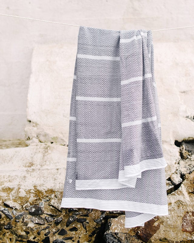 Mungo Tawulo - a pure cotton towel, photographed at Dalebrook Tidal Pool in Cape Town