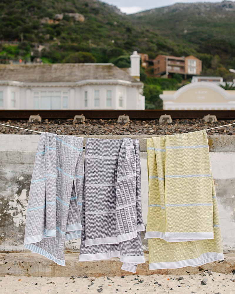Mungo Tawulo - a pure cotton beach or bath towel woven at the Mungo Mill in South Africa. Photographed at Dalebrook Tidal Pool in Cape Town