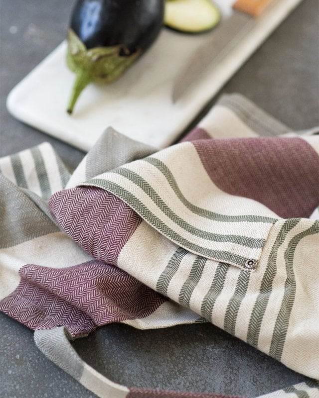 Close up of the Mungo Chef's Apron in Aubergine, woven at our mill in Plettenberg Bay, South Africa