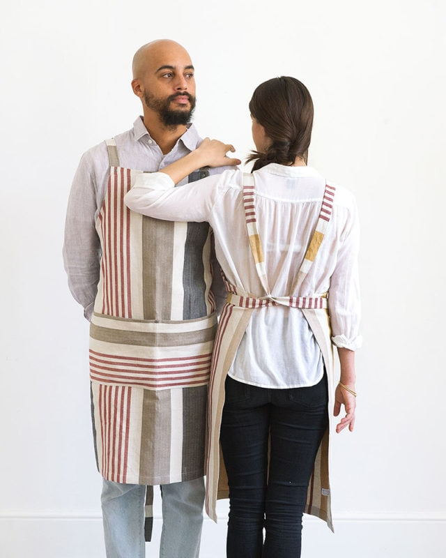 Models wearing the Mungo Chef's Aprons in Berry and Yam, woven at our mill in Plettenberg Bay, South Africa