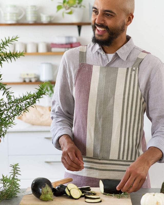The Mungo Chef's Apron in Aubergine in a kitchen scene.